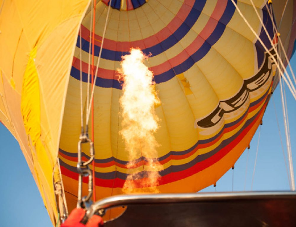 How does a hot air balloon differ from a gas balloon?